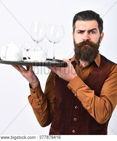 Barman With Thoughtful Face Serves Coffee Or Alcohol Beverages.