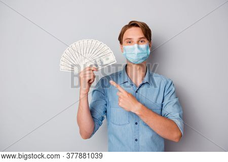 Portrait Of His He Nice Attractive Guy Wearing Safety Gauze Mask Holding In Hands Demonstrating Fan