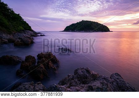 Long Exposure Image Of Dramatic Sky Seascape With Rocks In The Foreground Sunset Or Sunrise Scenery