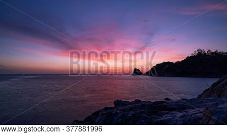 Amazing Beautiful Light Of Nature Dramatic Sky Seascape With Rock In The Foreground In Sunset Or Sun