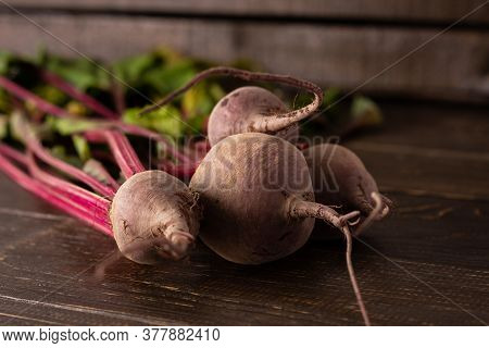 Fresh Harvest Beet, Beet With Green Tops On Brown Wooden Background Close-up