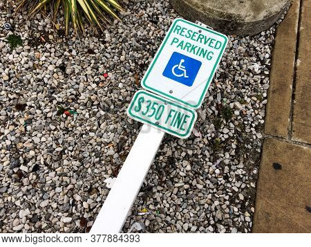 Handicap Parking Sign On Ground With Post Reserved Parking