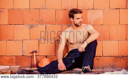 Attractive Worker. Handsome Sexy Laborer. Inspecting Building. Building Construction. General Mainte