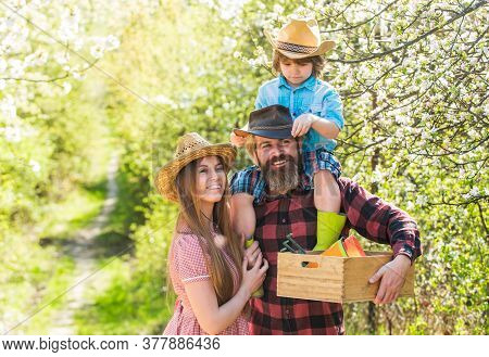 Hobby Brings Them Joy. Happy Family In Spring Garden. Family Hobby. Bearded Man And Woman With Child