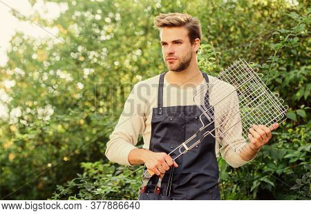 Enjoying Lunch Outdoors. Picnic Cooking Utensils. Outdoor Party Weekend. Man Barbecue Grill. Tools F