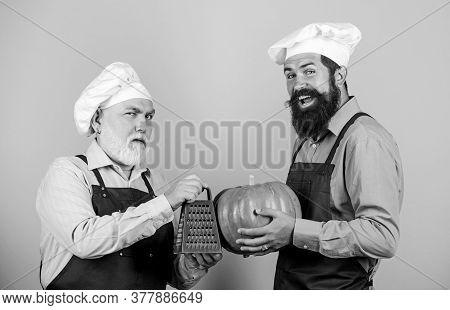 Health In His Hands. Mature Senior Bearded Men In Kitchen. Professional Restaurant Cook. Halloween P
