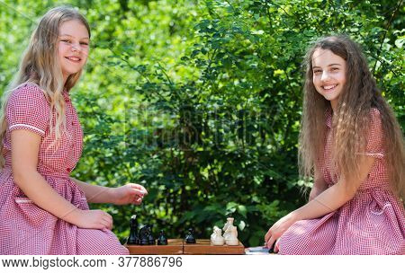 Competition Success Play. Two Teen Girls Play Chess In Park. Retro Kids Chess Players. Strategy Conc