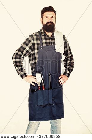 Masculine Hobby. Bearded Hipster Wear Apron For Barbecue. Roasting And Grilling Food. Man Hold Cooki
