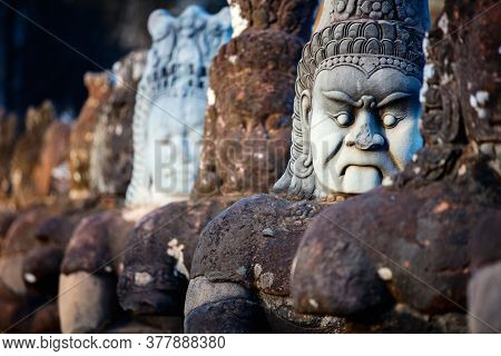 South Gate statues in Angkor Archeological area in Cambodia