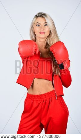 Sport And Sportswear Fashion. Girl In Boxing Gloves Punching. Training With Coach. Fight For Success