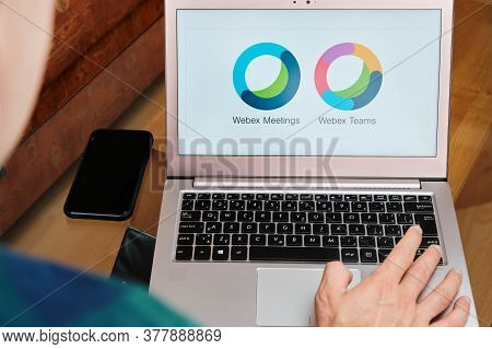 Webex Meetings Is Used For Business Meeting On Laptop By Man. An Illustrative Editorial Image. San F