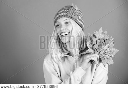 Feel Happy This Autumn. Woman Cute Face Wear Knitted Hat Hold Fallen Leaves. Autumn Skincare Tips. S