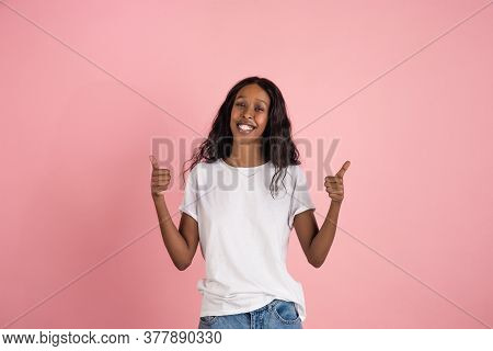 Thumbs Up. Cheerful African-american Young Woman Isolated On Pink Background, Emotional And Expressi