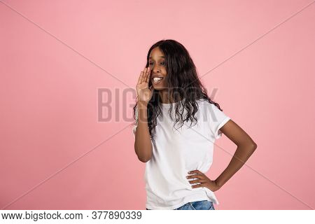 Whispering A Secrets, Gossip. Cheerful African-american Young Woman Isolated On Pink Background, Emo