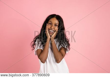 Cute Smiling. Cheerful African-american Young Woman Isolated On Pink Background, Emotional And Expre