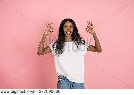Nice Sign. Cheerful African-american Young Woman Isolated On Pink Background, Emotional And Expressi