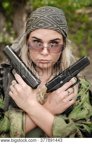 Attractive Female Army Soldier Posing With Gun. Woman With Weapon