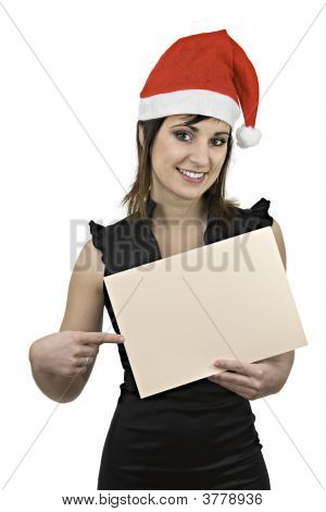 Smiling Girl With Santa Claus Cap And Blank Sign