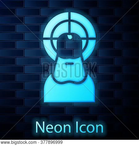 Glowing Neon Jesus Christ Icon Isolated On Brick Wall Background. Vector Illustration