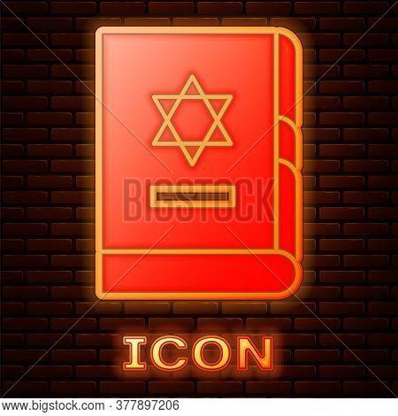 Glowing Neon Jewish Torah Book Icon Isolated On Brick Wall Background. On The Cover Of The Bible Is