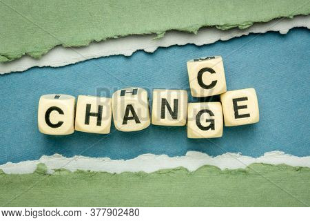 change and chance - word abstract in wooden cubes against handmade paper, opportunity in changing world concept