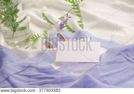 Wedding Mockup With Violet Flowers And Delicate Silk Ribbons On A White Background. Greeting Card Or