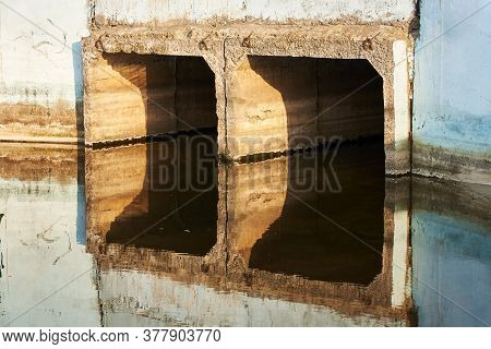The Outlet Collector For The Release Of Water From The Artificial Reservoir Is Reflected In The Wate