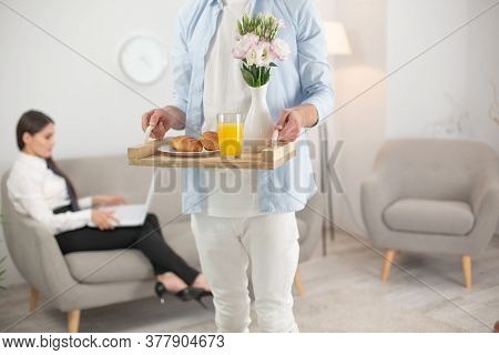 Man Bringing His Wife Food. Cropped Picture Of Man Holding Food Tray. Cropped Shot Of Male Wearing W