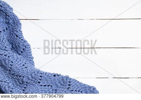 Knitted Woolen Blanket On White Wooden Background