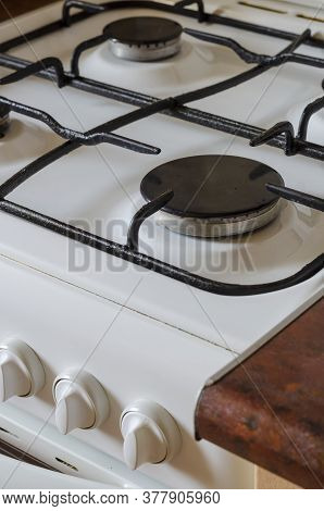 Dirty Stove With Drops Of Grease And Ghee. Side View Of A White Kitchen Stove Before Cleaning. Comme
