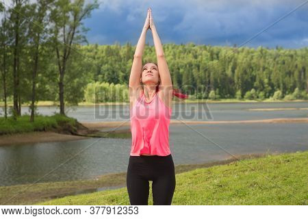 The Girl On The Nature In The Park Is Engaged In Yoga.