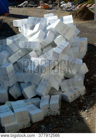 White Unspoilt Styrofoam Boxes In Front Of A Building For Thermal Insulation