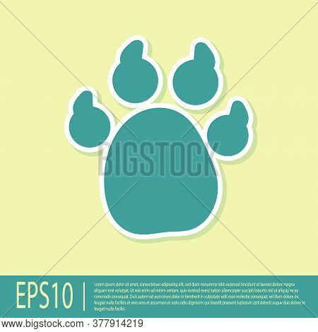 Green Paw Print Icon Isolated On Yellow Background. Dog Or Cat Paw Print. Animal Track. Vector