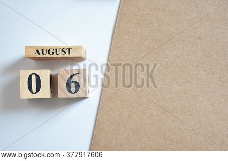 August 6, Empty White - Brown Background With Number Cube.
