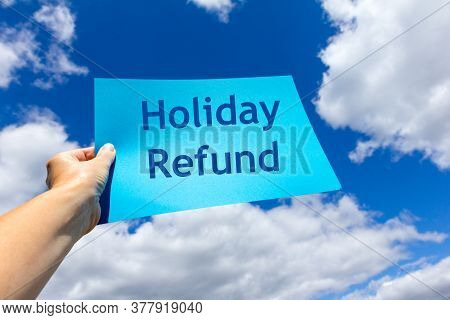 Refunds Concept - Person Holding A Statement Towards The Sky - Holiday Refund