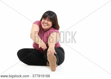 Fat Asian Women Exercise Stretching Muscles. In Order To Want To Lose Weight. The Concept Of Health
