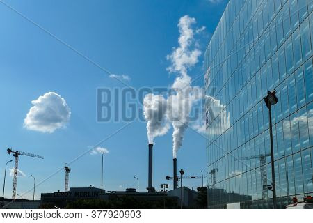 Paris, France. July 11. 2020. Silhouette Of A Factory With Its Chimneys. Polluting Industrial Smoke