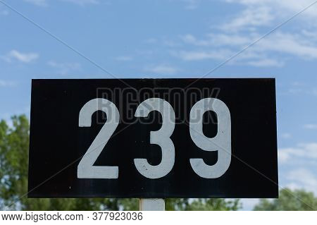 A Low Angle Shot Of A Signpost With 239 Number On It