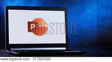 Laptop Computer Displaying Logo Of Microsoft Powerpoint