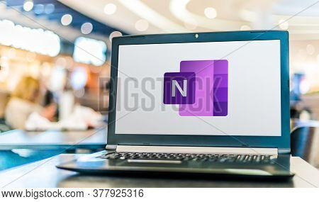 Poznan, Pol - Apr 28, 2020: Laptop Computer Displaying Logo Of Microsoft Onenote Program, Part Of Th