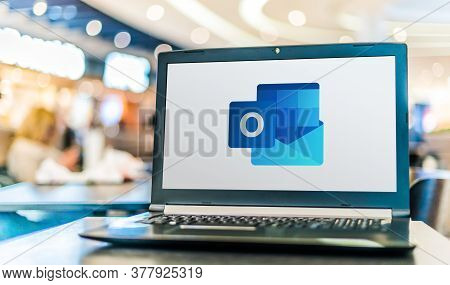 Poznan, Pol - Apr 28, 2020: Laptop Computer Displaying Logo Of Microsoft Outlook Program, Part Of Th