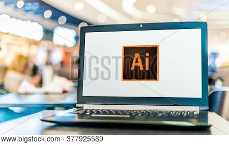 Poznan, Pol - May 21, 2020: Laptop Computer Displaying Logo Of Adobe Illustrator, A Vector Graphics