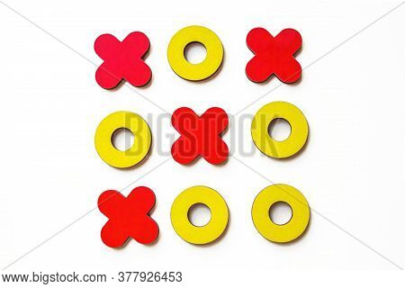 Kid Tic-tac-toe Wood Board Game On White Background. Developmental Game For Children. Family And Fri