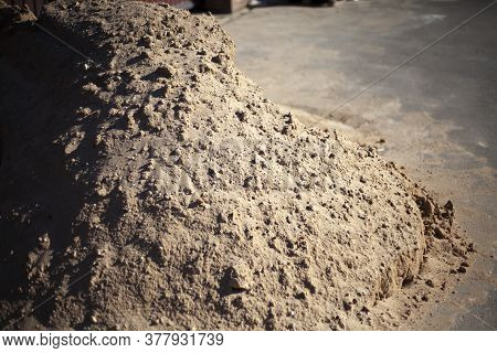 Building Material Sand. Sand To Create A Road. Construction Material. Bringing Sand To The Summer Co
