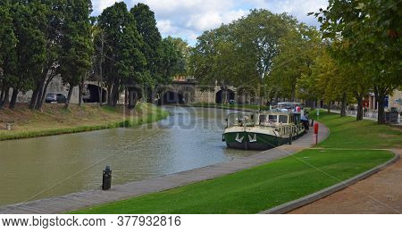 Canal Du Midi At Carcassonne Languedoc Roussillon France.with Barge.