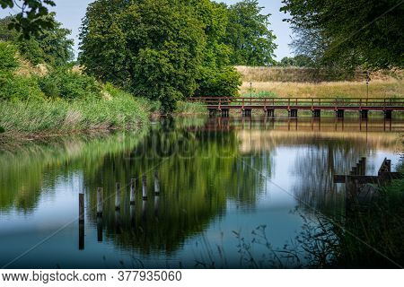 A Moat Protecting An Old Fortress In Landskrona, Scania, Southern Sweden. Beautiful Reflections Of T