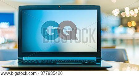 Laptop Computer Displaying Logo Of Gq
