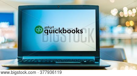 Laptop Computer Displaying Logo Of Quickbooks