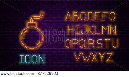 Glowing Neon Line Bomb Ready To Explode Icon Isolated On Brick Wall Background. Neon Light Alphabet.