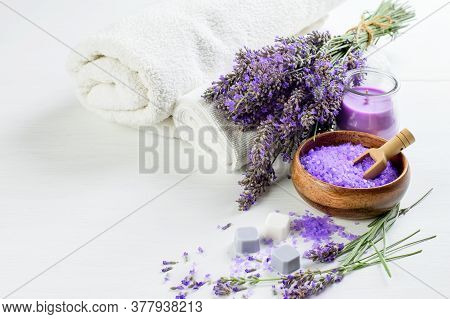 Lavender Products For Spa Aroma Therapy:lavender Flowers, Salt, Soap, Candle And White Towels. Healt